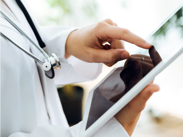 Doctor using a tablet.