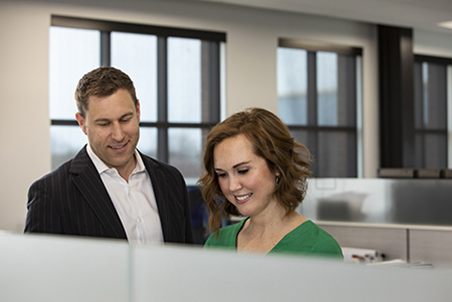 Andy Vetor and Nicole Fonner in the office.